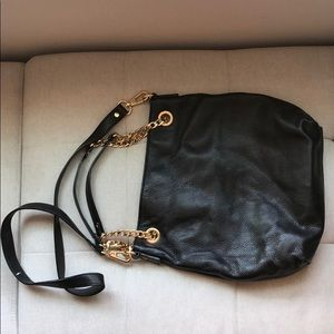 Black and gold strapped Michael Kors Purse